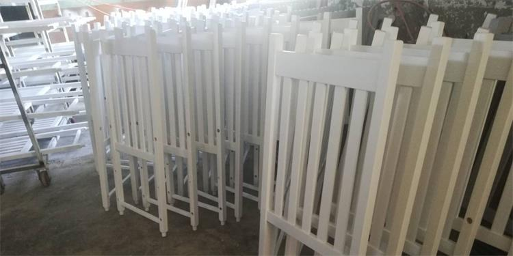 back of white rocking chairs