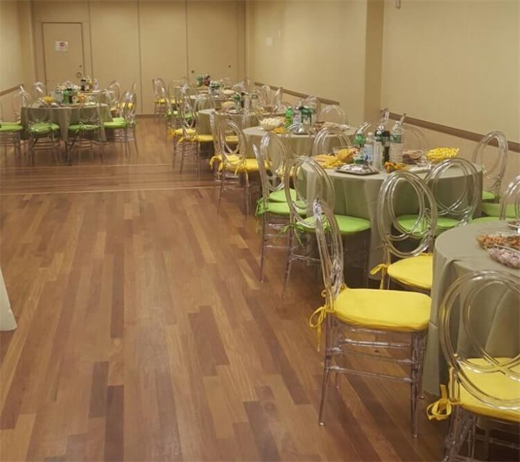 clear chairs with yellow cushion