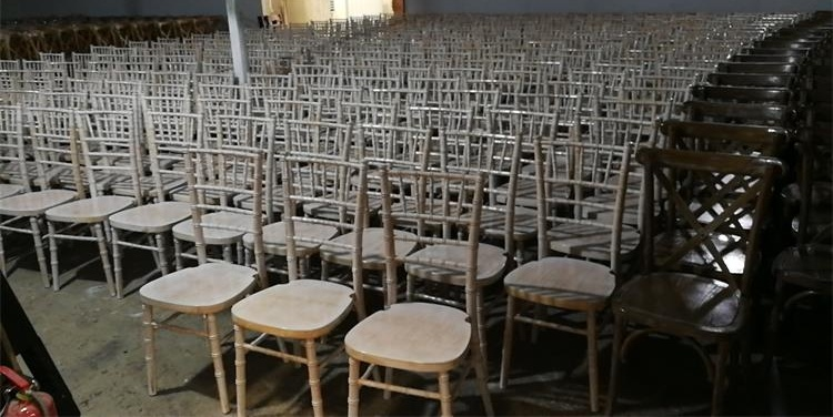 production of white washed chiavari chairs