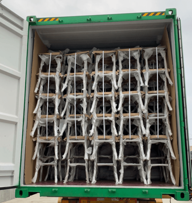 loading container of crossback chairs