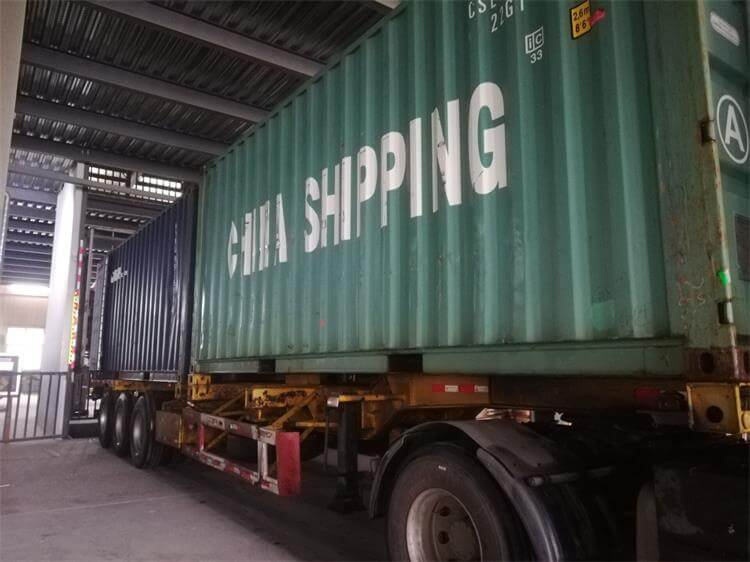 loading container of phoenix chairs