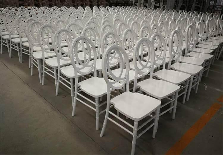 white wooden phoenix chairs