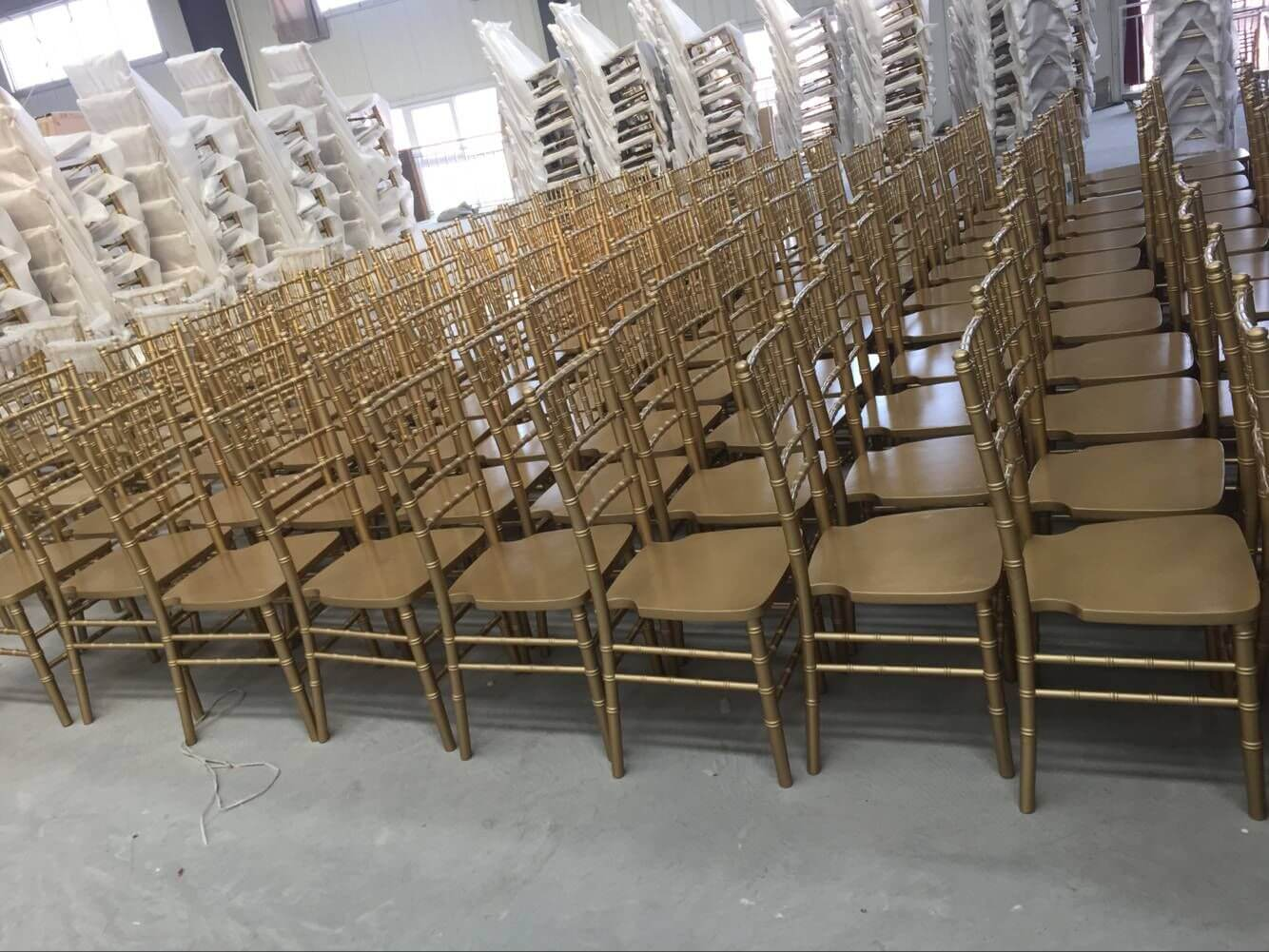 Primer painting of gold chiavari chairs