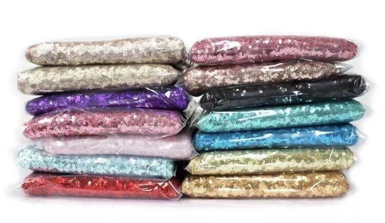 package of sequin table cloths